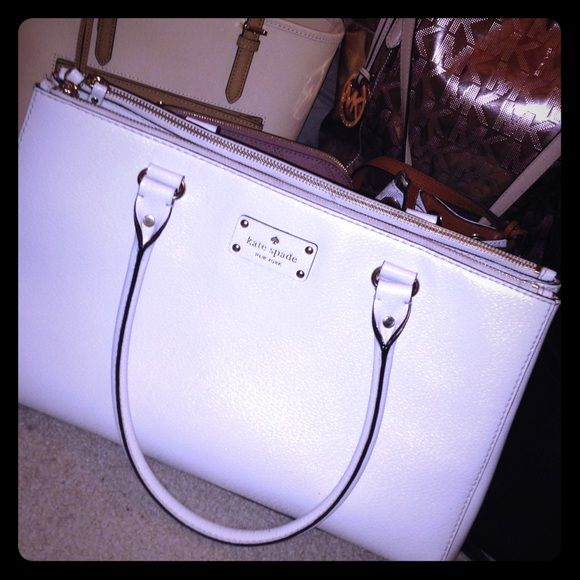 ⚡️Kate Spade with the flash on ⚡️ ♠️Kate Spade Wellesley Martine bag ♠️100% authentic ♠️White creamy look ♠️Has pink & red polkadots on the inside. ♠️Main pocket snaps shut then has zipper pockets on both sides ♠️Very big and roomy ♠️Flawlessly ♠️WILL TRADE♠️♠♠️️TRADE VALUE: $475!♠️♠️♠️ kate spade Bags