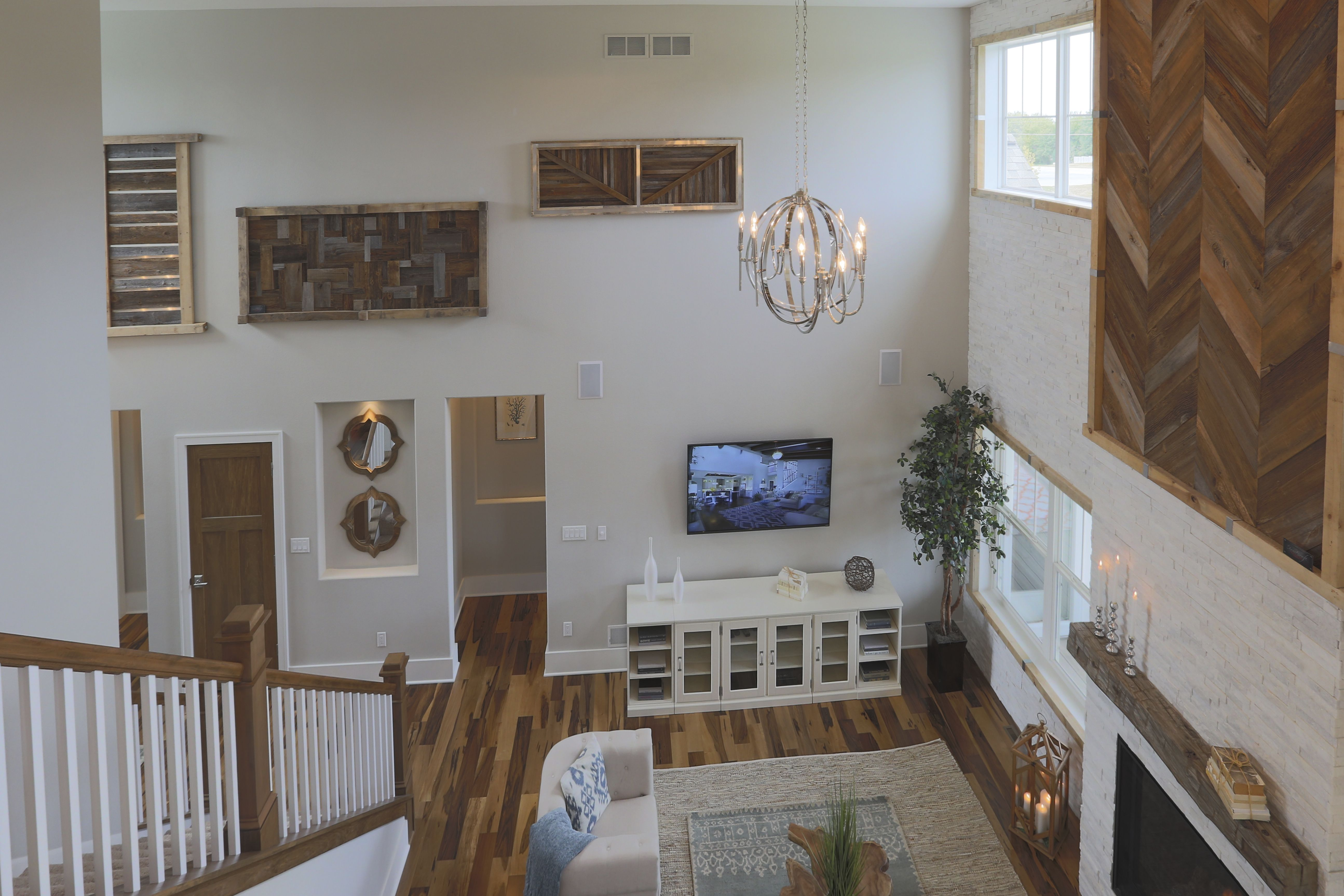 Azalea Parade Home - second floor view of the Great Room. Natural wood and white accents. #TimOBrienHomes
