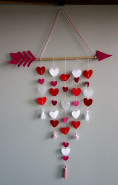 How to make a Cupid's Arrow Valentine's Day Wall Hanging using felt, a dowel, and some embroidery floss. I
