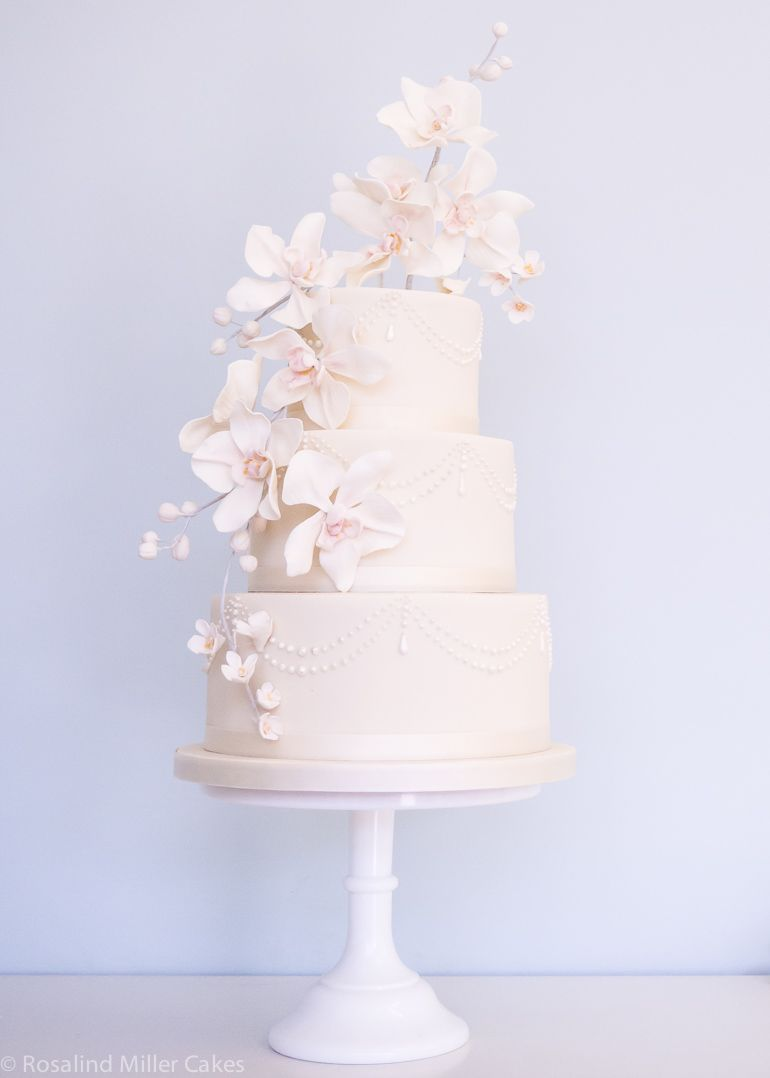 Orchids, Pearls and Drapes Wedding Cake by Rosalind Miller Cakes London