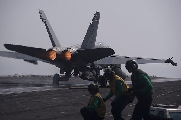 GULF OF OMAN(Oct.10,2013)F/A-18C Hornet,from Checkerboards of Marine Fighter Attack Squadron (VMA) 312,launches from flight deck of aircraft carrier USS Harry S. Truman (CVN 75).Harry S. Truman, flagship for the Harry S. Truman Carrier Strike Group,deployed to the U.S. 5th Fleet area of responsibility conducting maritime security operations,supporting theater security cooperation efforts & supporting Operation Enduring Freedom.(USN Mass Comm Spec Seaman Karl Anderson)