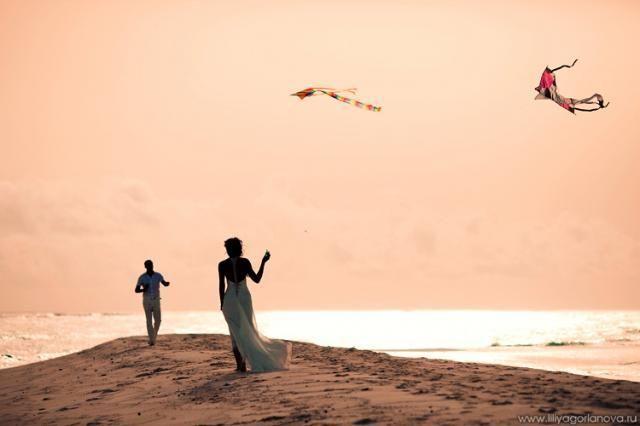 Couple flying kites