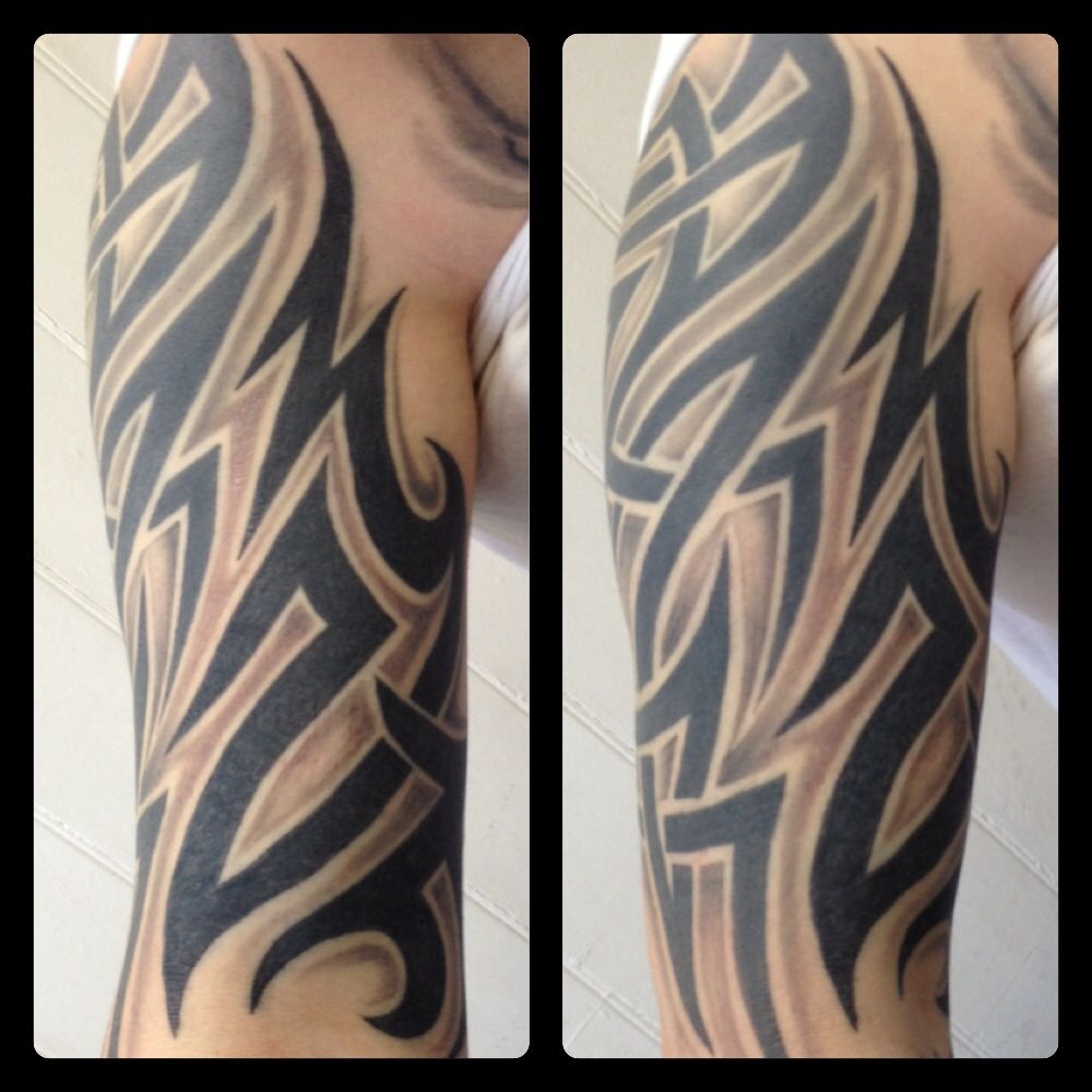 Tribal extension tattoo on inner arm. By Danie Doolally