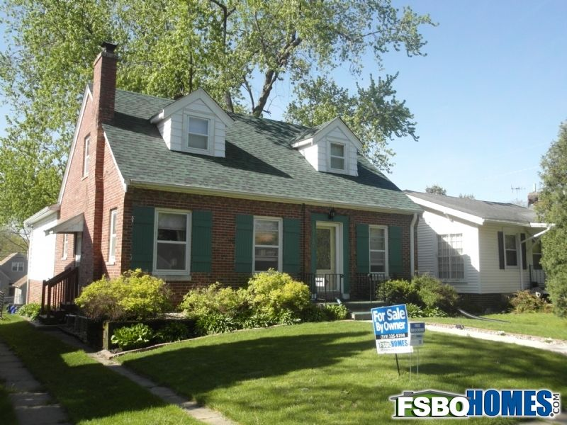 Beautiful 1.5 story three bedroom brick home! Includes a