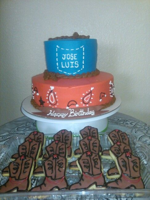 Cowboy theme blue and red bandana style cake with boot sugar