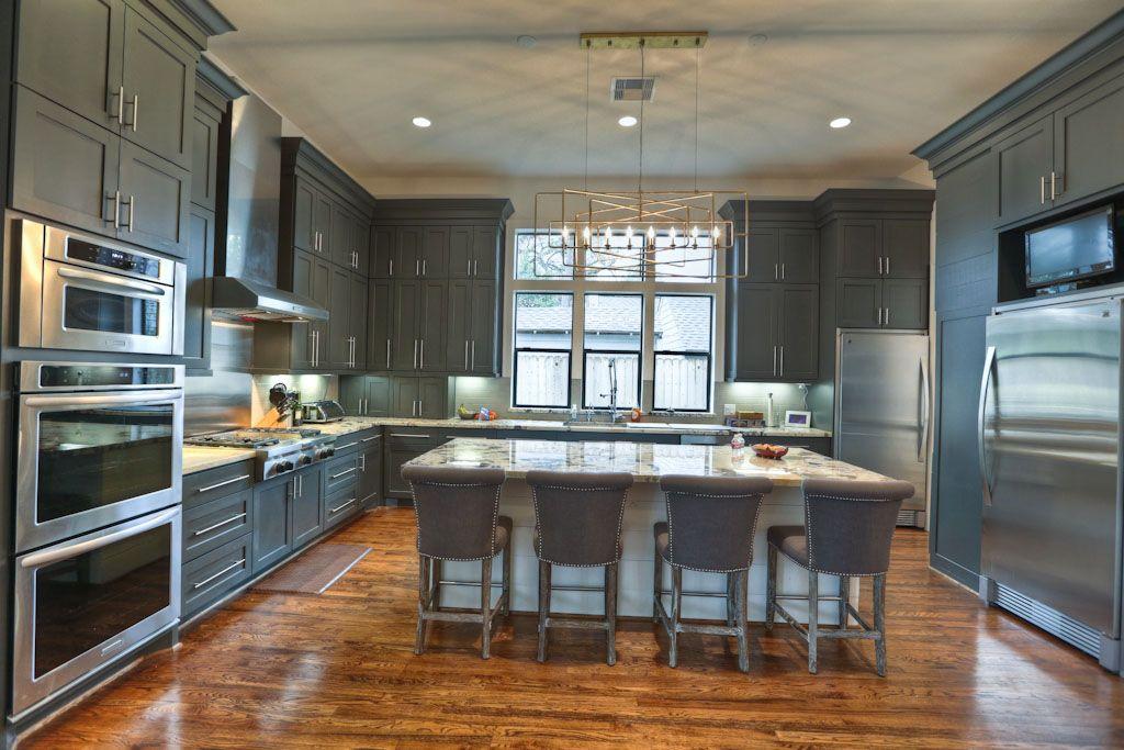 dark gray kitchen with contrast island and wood floors dark grey kitchen interior design on kitchen interior grey wood id=20942