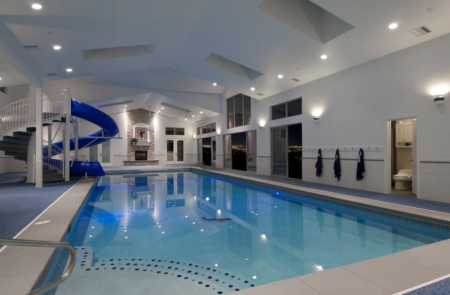 Cool Swimming Pools With Slides a lavish indoor pool can be visually connected with your living