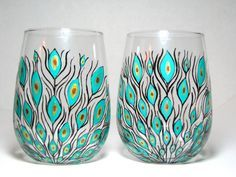 These wine glasses contain a beautiful peacock feather design