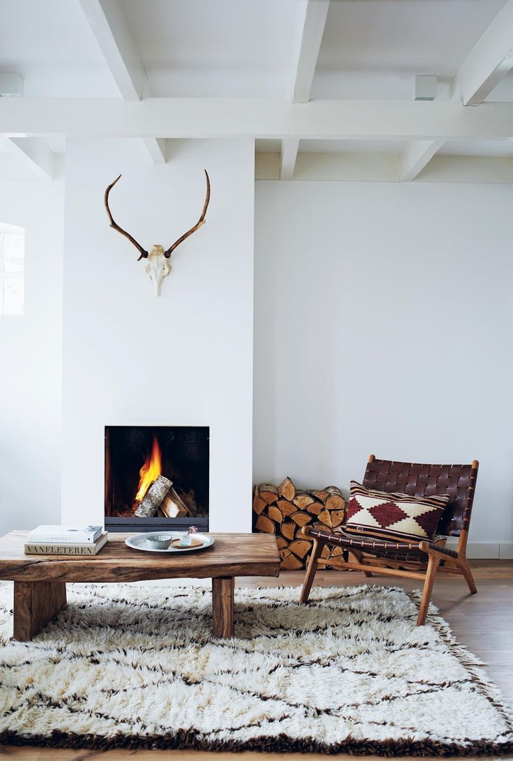 Rustic Scandinavian Living Room With A Fireplace Bull Head And Moroccan Rug