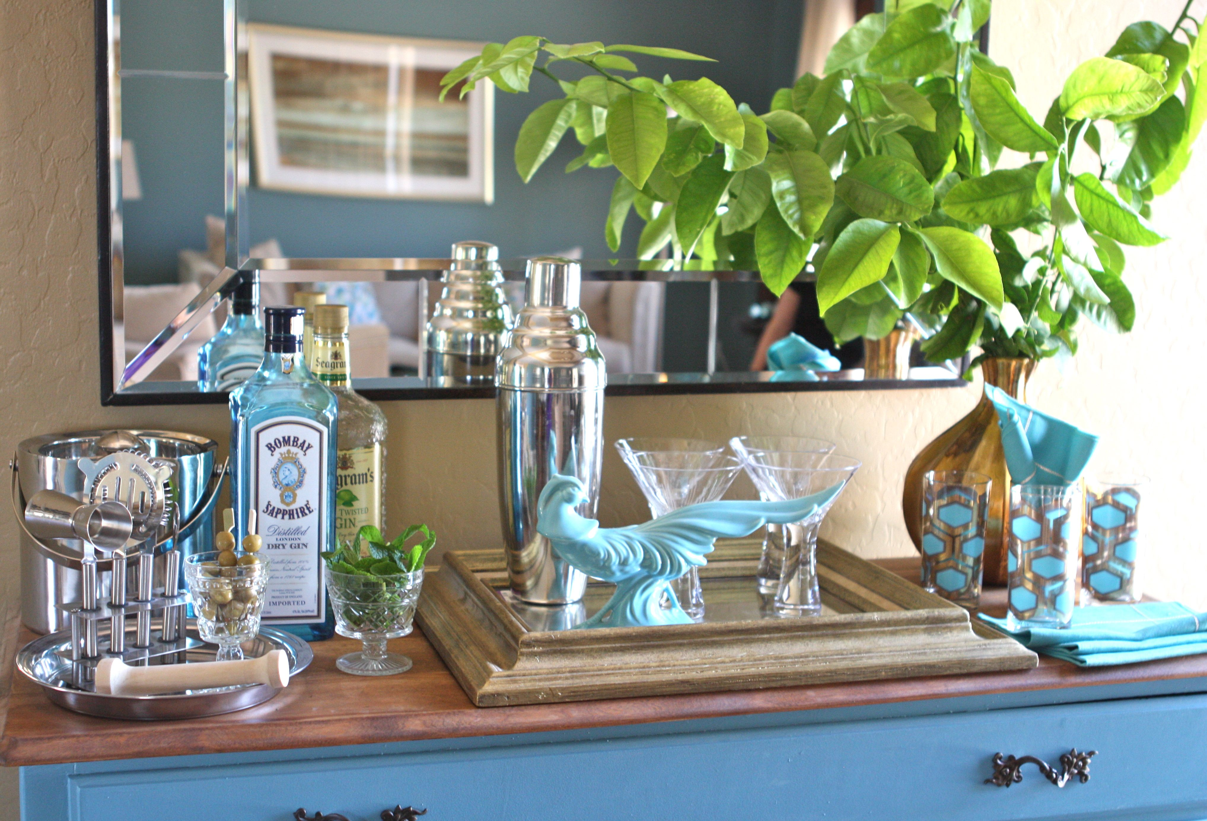A fresh turquoise and gold cocktail display with items from