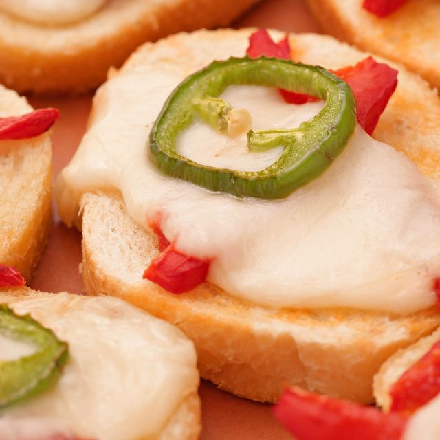 Learn how to make Melted Roasted Red Pepper-Mozzarella Toasts With Fresh Jalapeño.