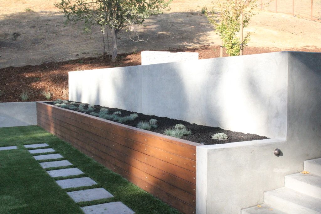 Concrete Retaining Wall We Offer Custom Concrete Solutions Including Polished Concrete Stained Concre Concrete Retaining Walls Retaining Wall Stained Concrete