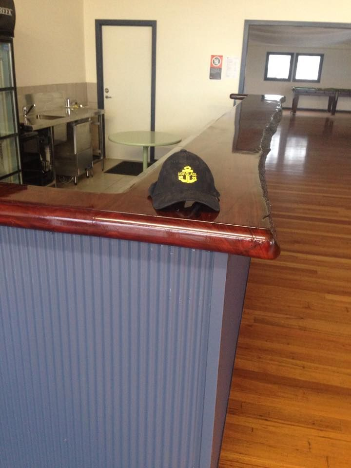 This Bar Top Was Finished Using Liquid Glass To Fill In Any Irregularities  In The