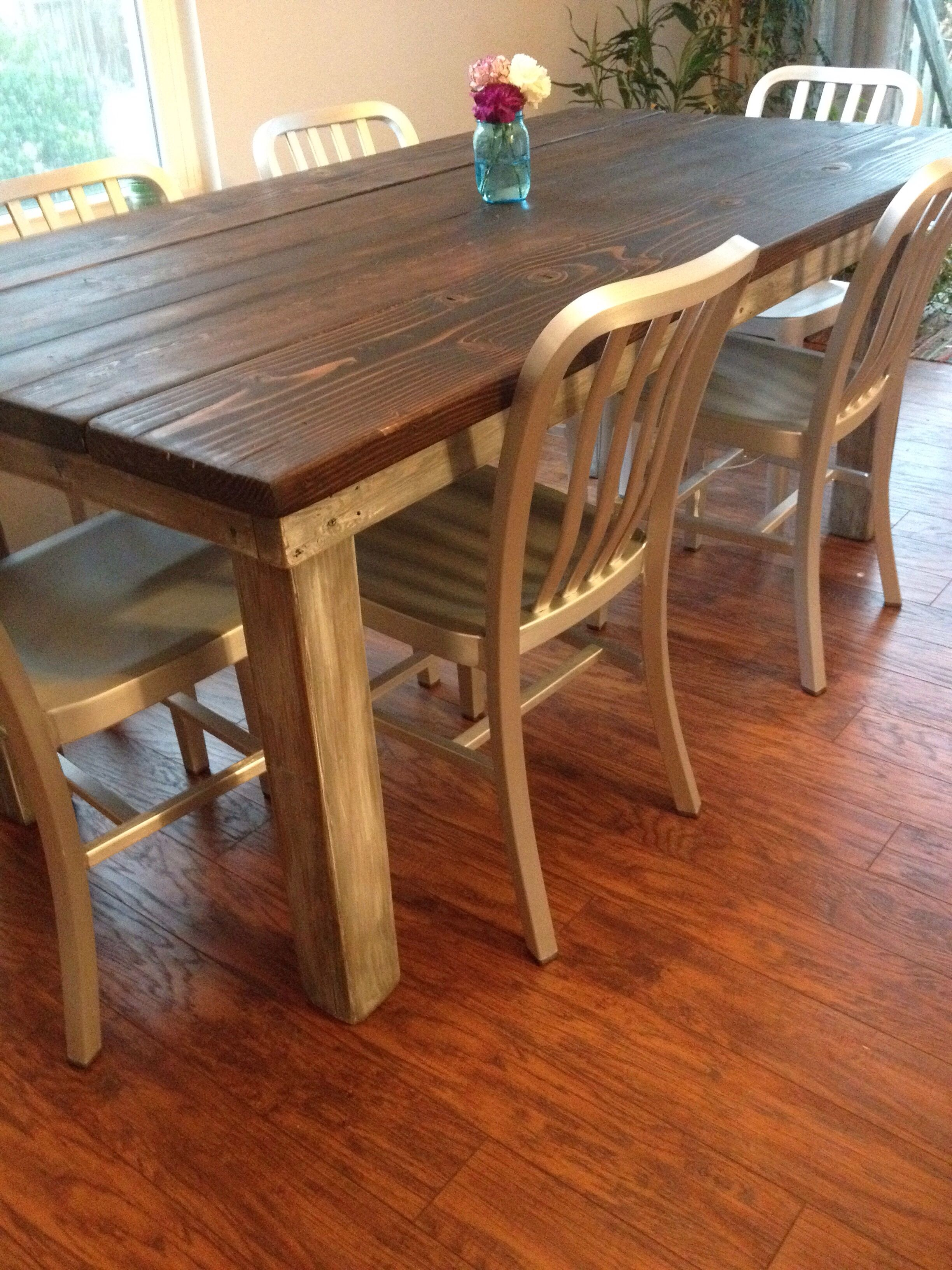 Custom planked top farmhouse table with dark walnut stain and  white washed gray. Custom planked top farmhouse table with dark walnut stain and