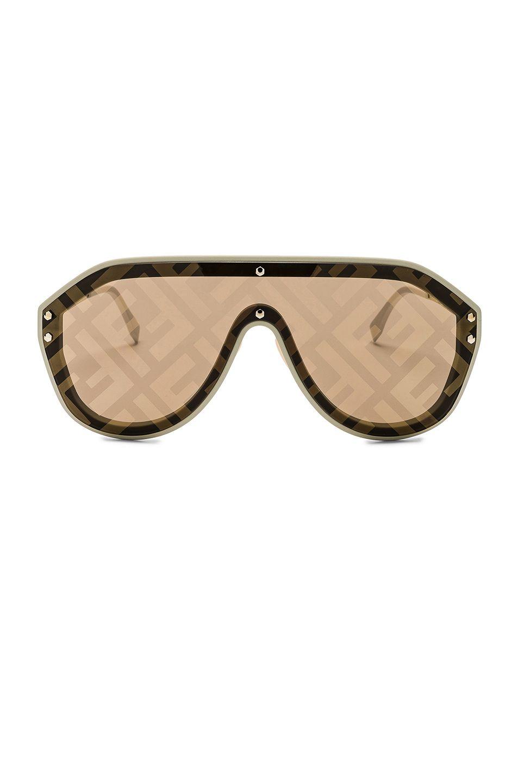 70965ed5a6ce Fendi Logo Face Sunglasses in Beige   Gold Decor