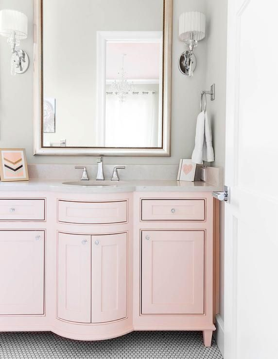 Pink And Gray S Bathroom Features A Silver Leaf Beaded Mirror Lining Wall Placed Over Curved Washstand Adorned With Gl Topped