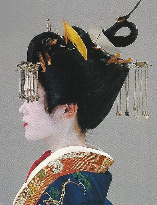 Scan A4. Scans from book: 300 years of Japanese women's appearance, kimono, kanzashi etc. ISBN4-87940-541-8. An incredible set of shots of a tayuu (courtesan) dress.  The opulant heavily-embroidered uchikake (outer kimono) and obi appear to date to the mid-19th century.  Images scanned by Lumikettu of Flickr