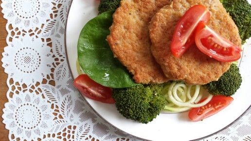Homemade chicken burgers and a small zoodle-broccoli-spinach salad