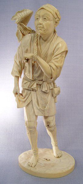 JAPANESE CARVED IVORY FIGURE OF A GARDENER: Highly detailed from the folds of the fabric to the expression on his face and plants in the basket. Artist signed. He appears to have had something attached at the knee. 10 1/2'' h., the base is 4'' dia.