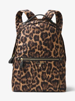 7c7b320a41dcb5 Our Kelsey backpack is a trusty companion for the girl on the go. Crafted  from durable leopard-print nylon with leather trim, it has a roomy interior  and a ...