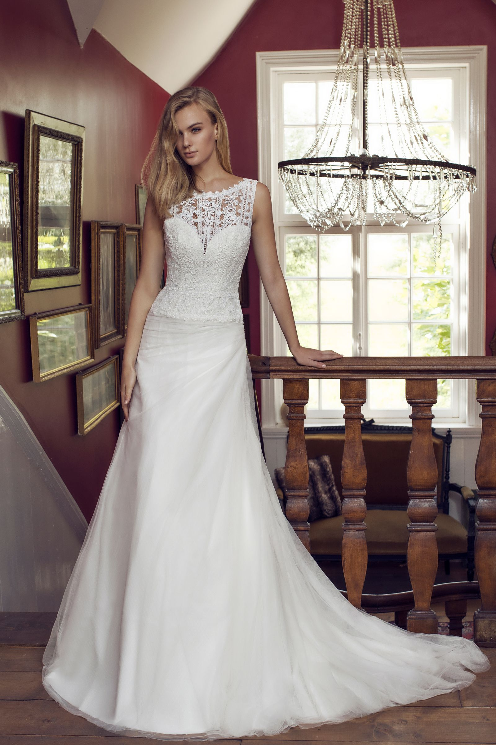 706012e5faef A combination of Tulle and Organza in this  Romantic  WeddingDress  Daphne.  The tulle top has an  IllusionNeckline made of beautiful  Lace.