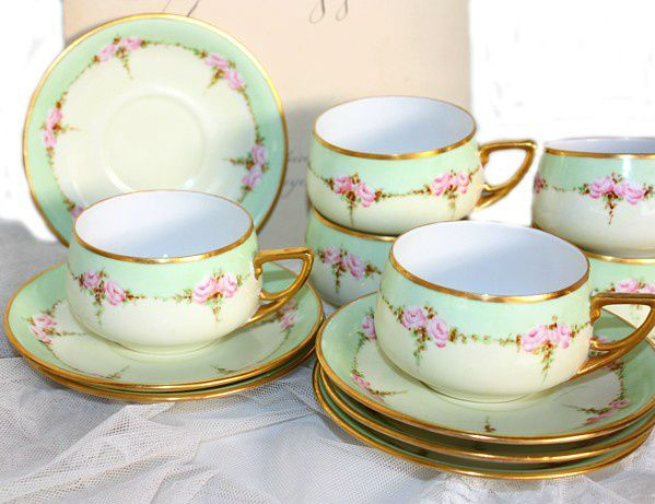 Antique set of handpainted apple green and pink roses KPM porcelain teacups and saucers.
