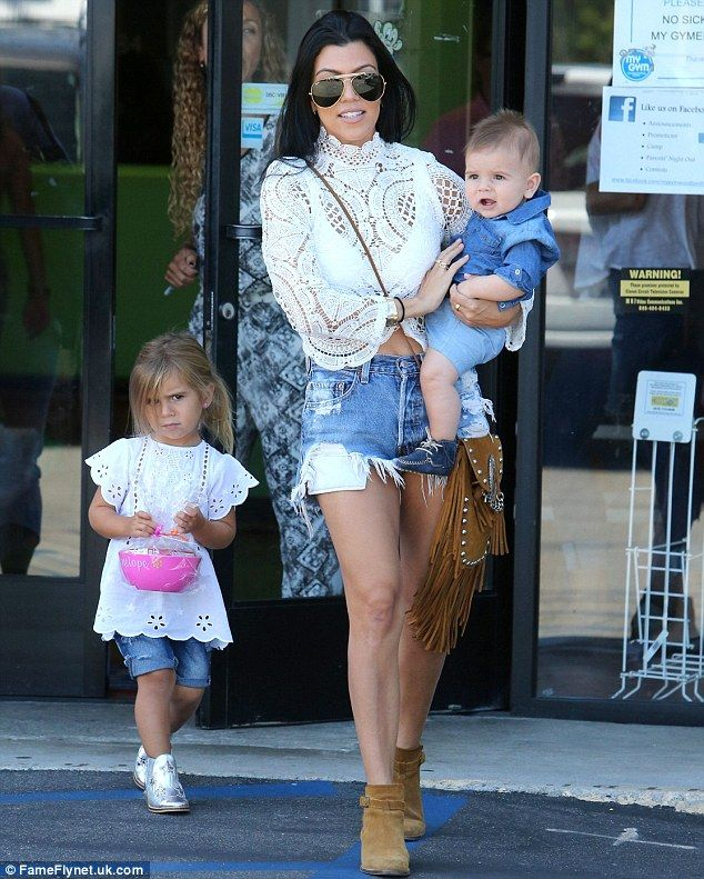 13f8c79f55af Kourtney Kardashian reveals her incredible figure in Daisy Dukes. Full  load: She was accompanied by three-year-old daughter Penelope and  seven-month-old son ...