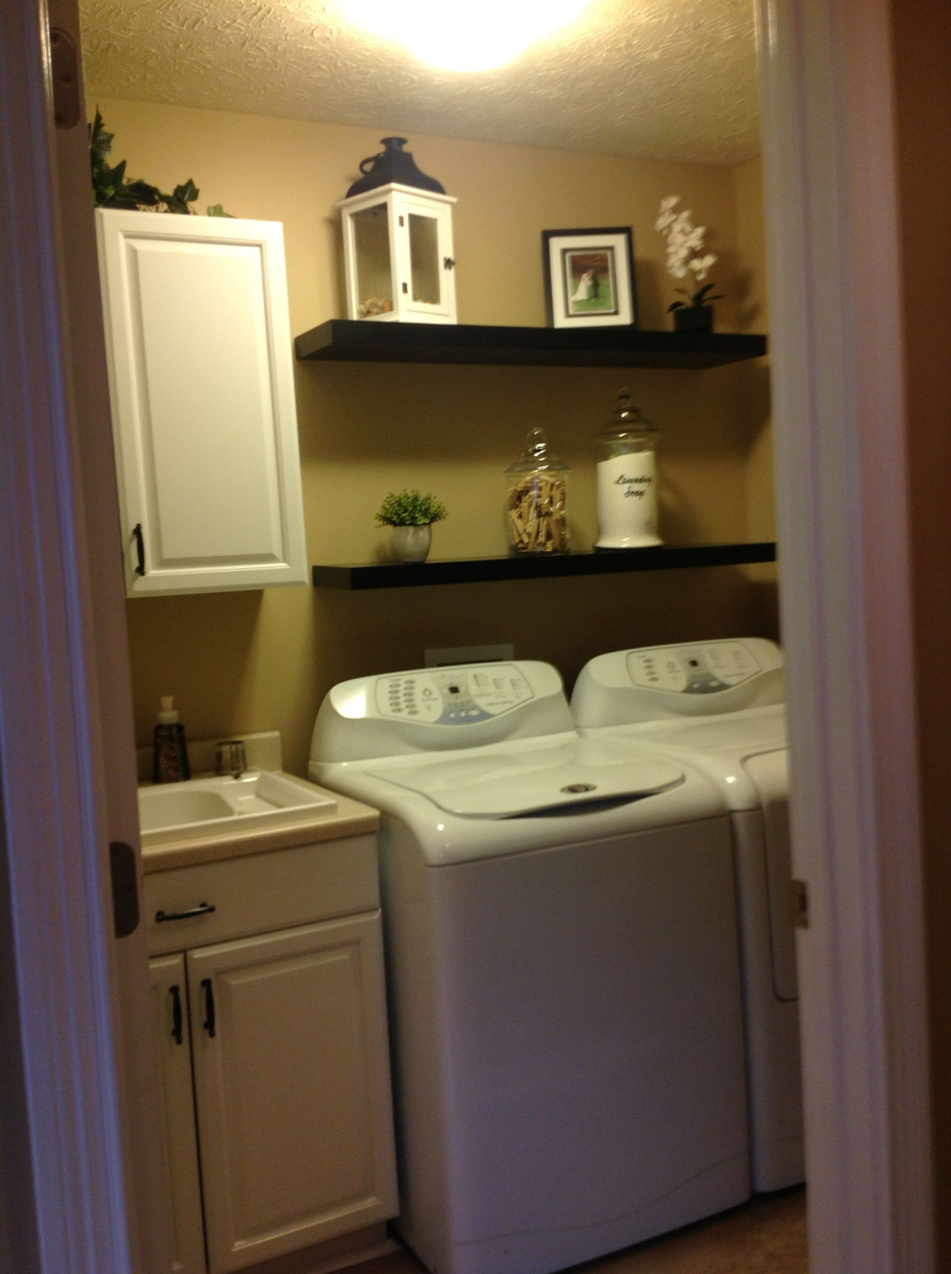 This is my newly updated laundry room Painted my oak cabinets white