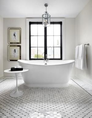 Luxurious minimal bathroom design with white and walls painted #EdgecombGray by Benjamin Moore.