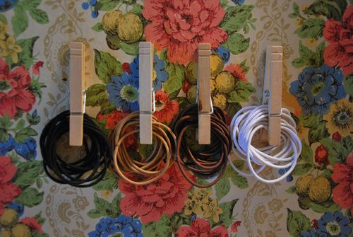 Clothespins holding hair bands/ bathroom organization