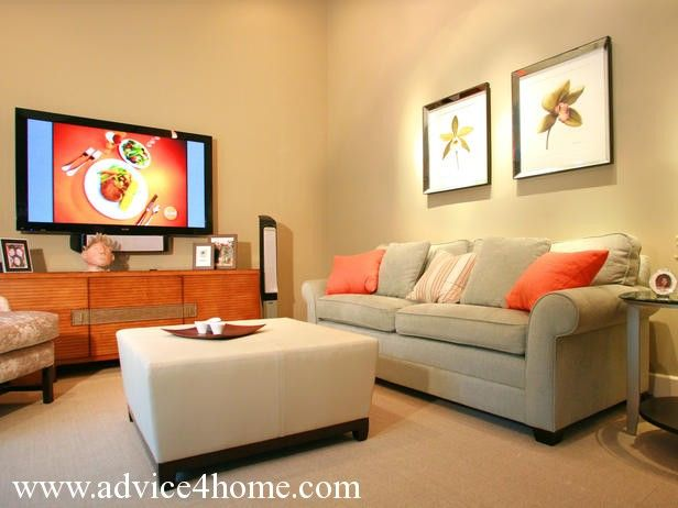 gray sofa design and cream wall design with photo frame and LCD TV ...