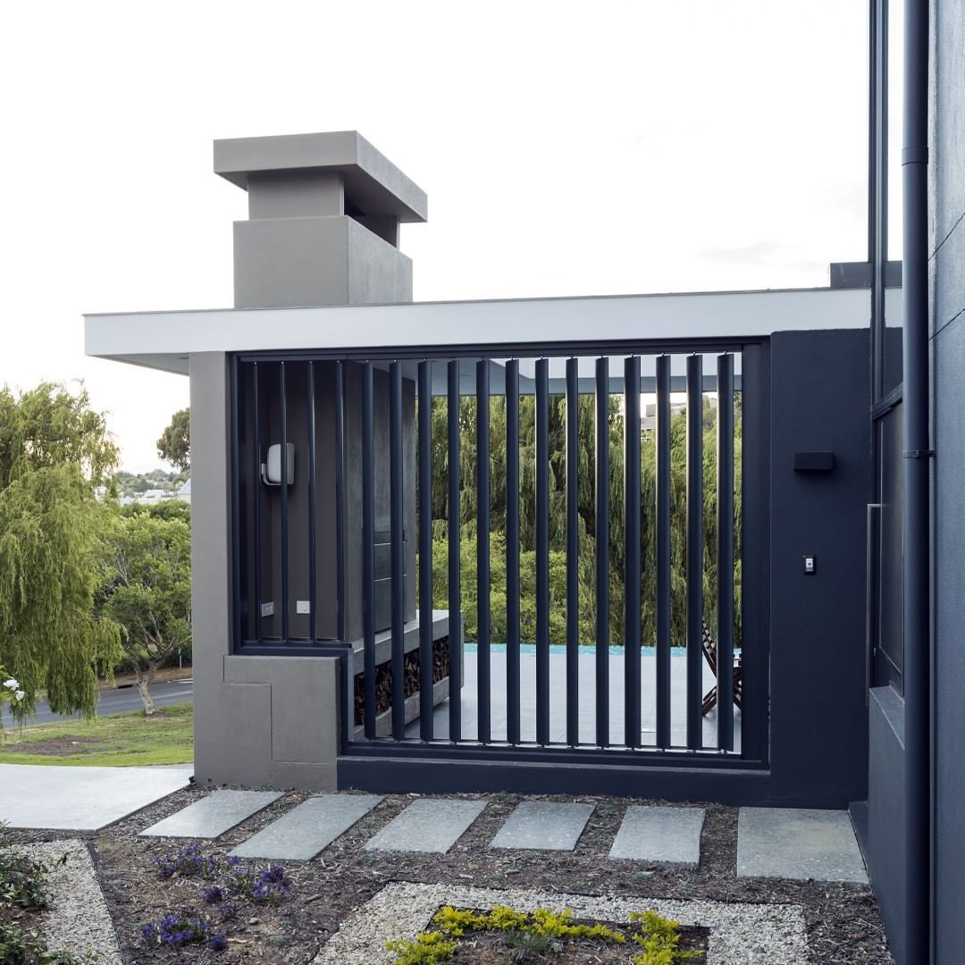 Thought out detail and construction to every project.  This louvered wall can be opened to allow a breeze to flow through or closed to block the wind.  Structural in the landscaping to compliment the architecture.