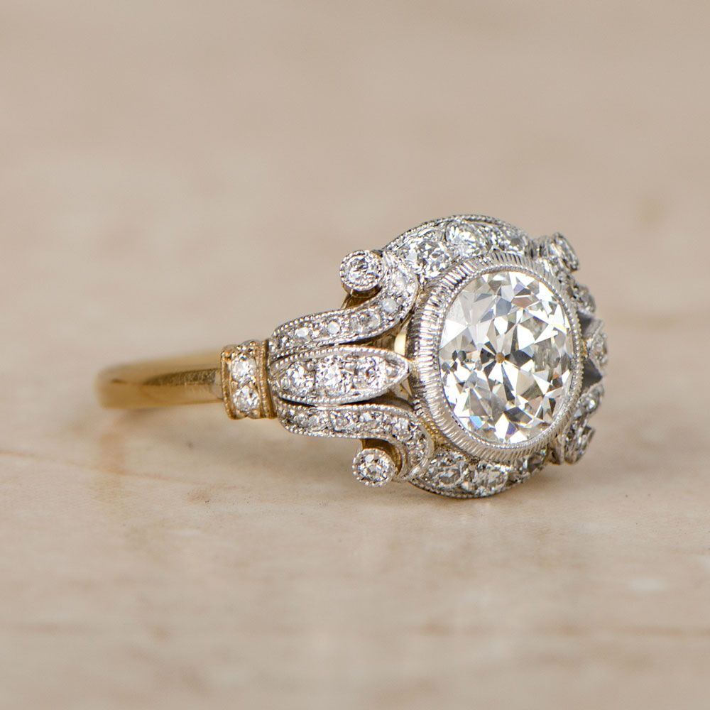 platinum once in estate ring upon a products flower with diamond baguettes