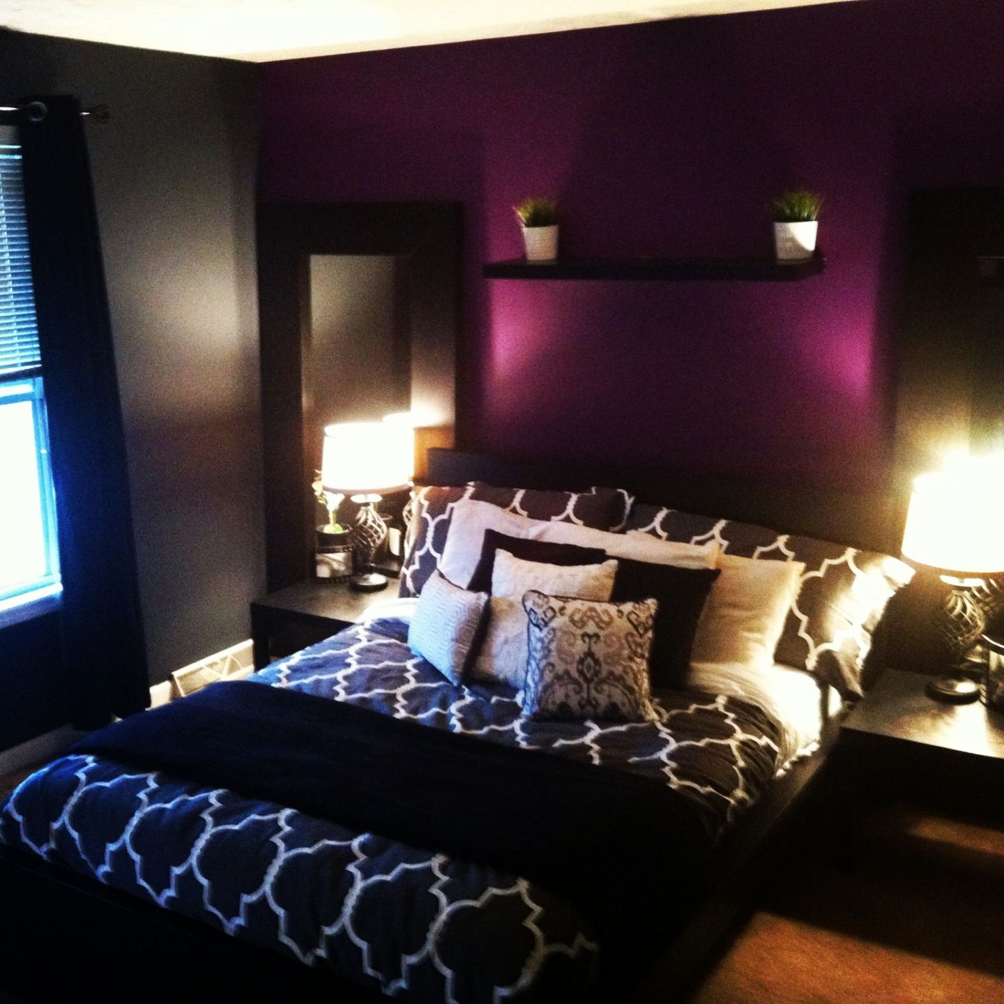 Grey Bedroom With Purple Accent Wall.