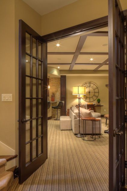 Basement--Tall-Order Design for a Lower-Level Lounge. Like everything but the flooring and the style of brick.: