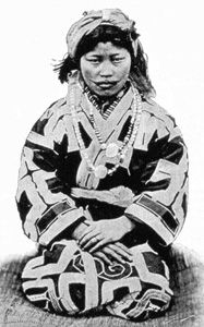 Ainu woman wearing attush garment with magical embroidery, ca. 1890. The embroidery, like tattooing, was believed to keep evil spirits from entering the body.