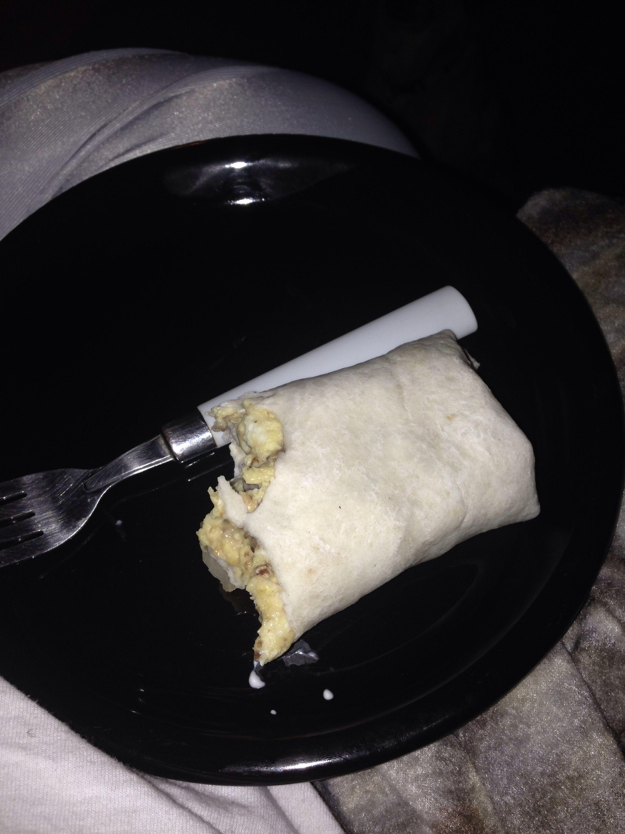 Breakfast burrito. Potatoes, sausage, egg, cheese.