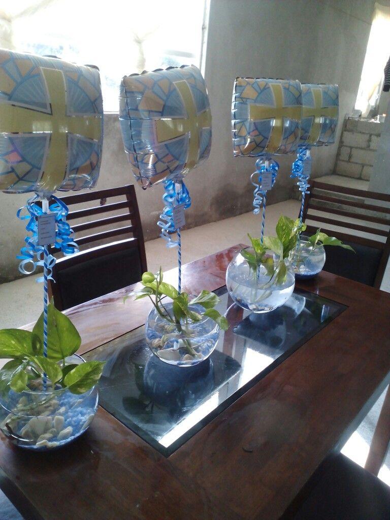 Centros de mesa con peces bautizo pinterest for Centros de mesa con peceras