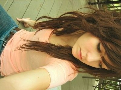 Emo girl with curly brown hair