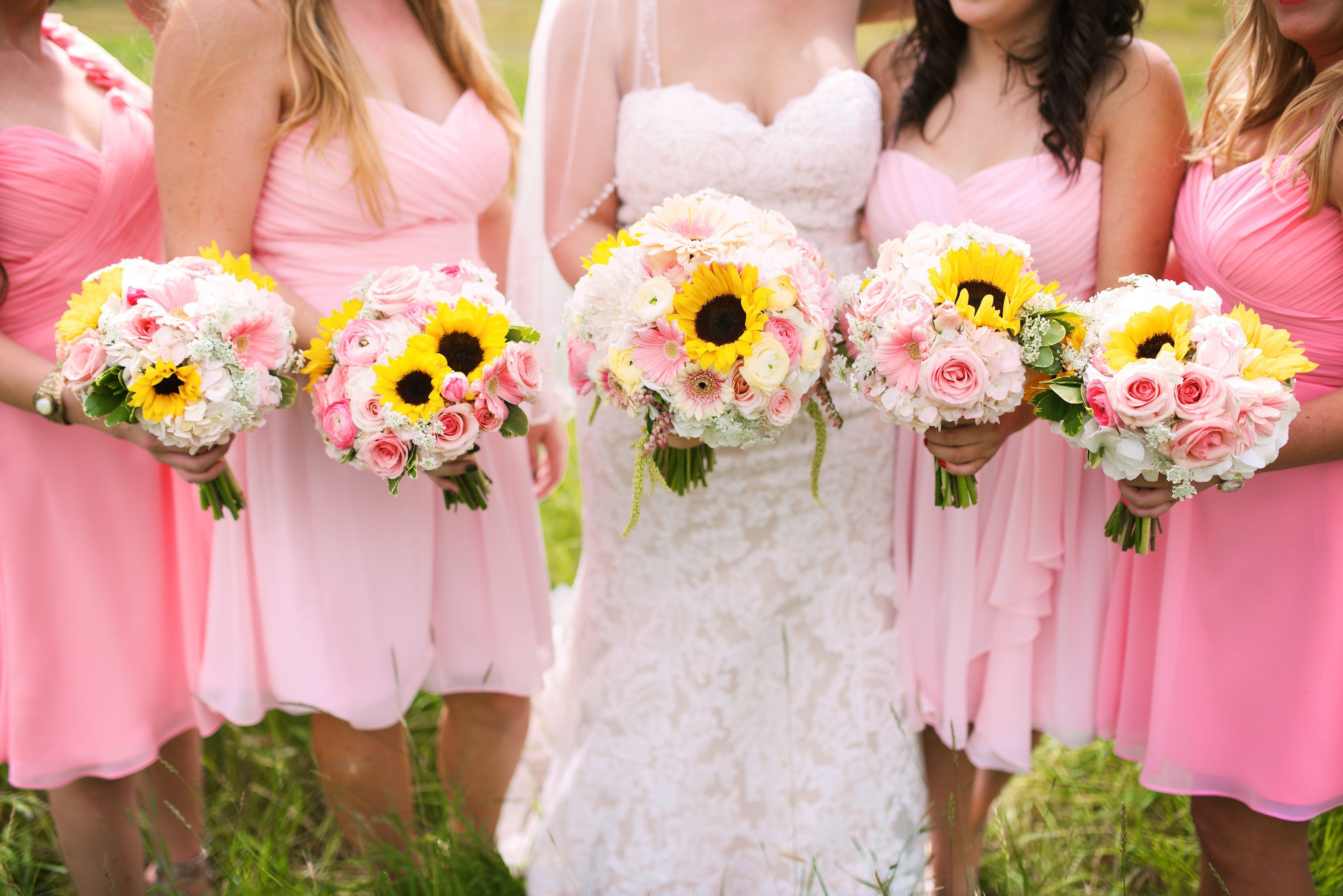 Bridal flowers of pink and yellow featuring sunflowers, gerber ...