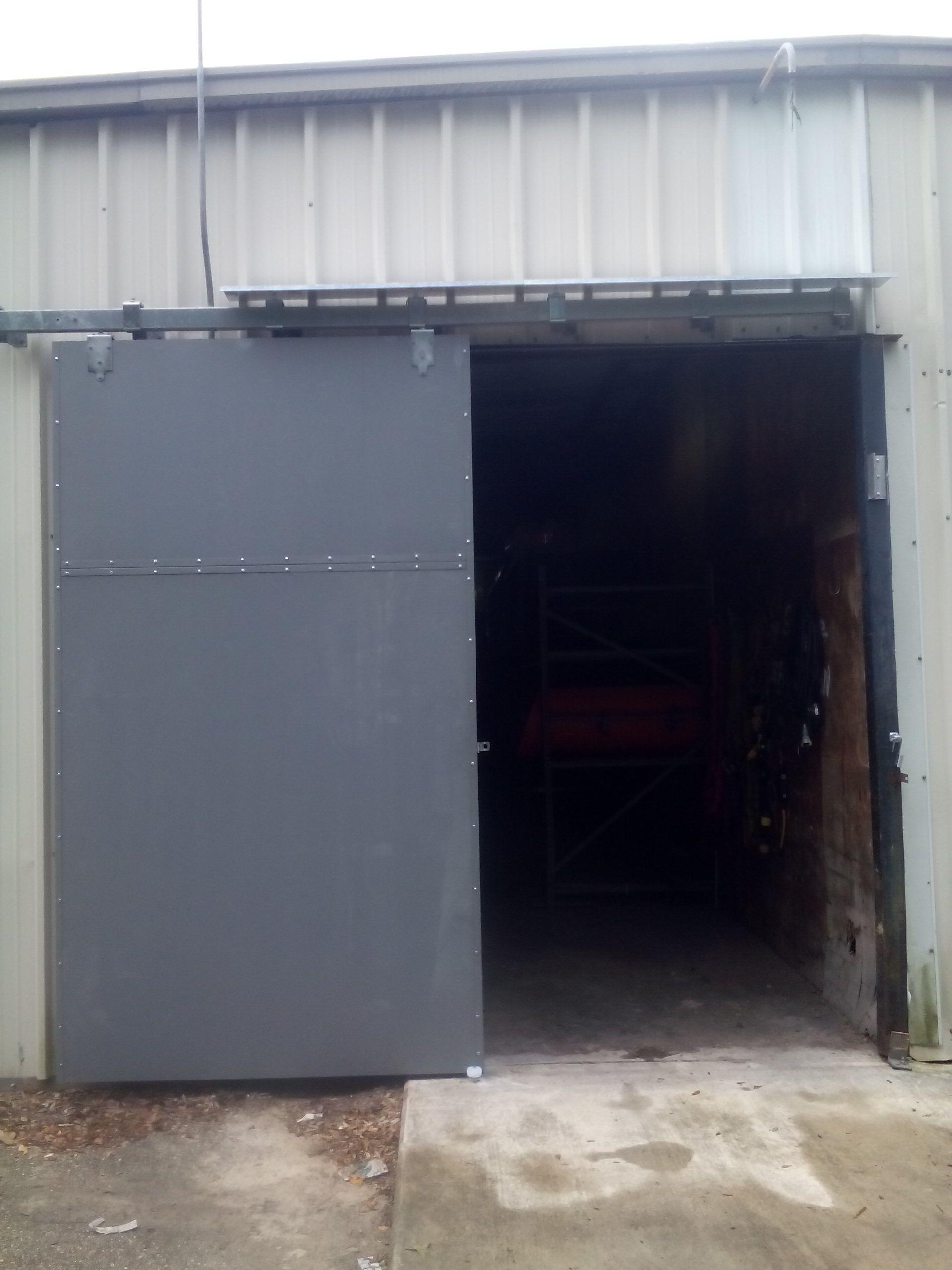 Ideal Door 10 Ft X 10 Ft 4 Star Sandtone Raised Pnl Non Insul Torsion Garage Door At Menards Post Frame Building Garage Doors Building Materials
