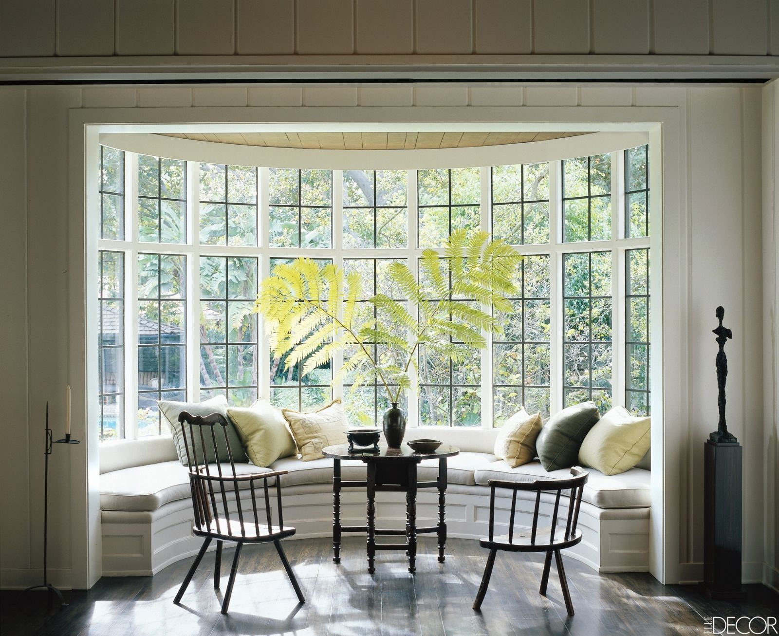 How To Create A Bright And Breezy Sunroom You Ll Love Bow Window Sunroom Designs Bay Window Seat