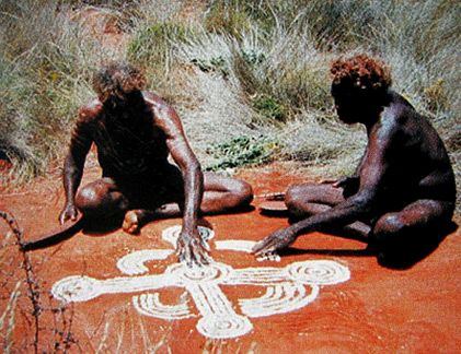 Old Walter Tjampitjinpa & Squeaky Mick Tjakamarra at Pupunya. In a sand drawing the representations or word pictures interacted with each other and replicated each other as the story teller moved his hand in all directions to create new relationships and meanings: as the visual words were wiped away new words were put down retranscribing the story-thought and carrying the narrative along...I came to understand the word finished for the western desert paintings was an imposed concept and…