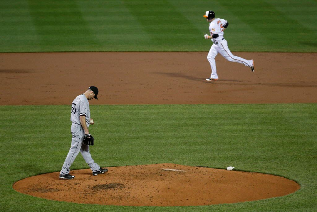 White Sox pitcher John Danks walks on the mound as the Orioles' Mark Trumbo rounds the bases after hitting a solo home run Thursday. (AP Photo/Patrick Semansky)