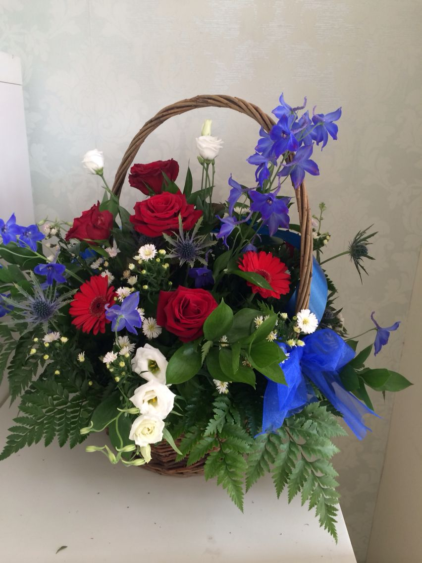Blue White and red basket of flowers Flower delivery