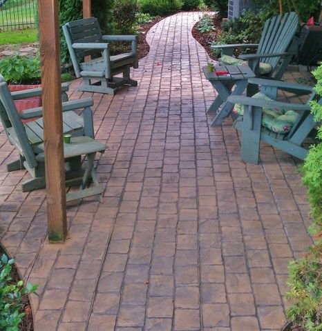 stamped concrete patio featuring a coble fieled brick pattern