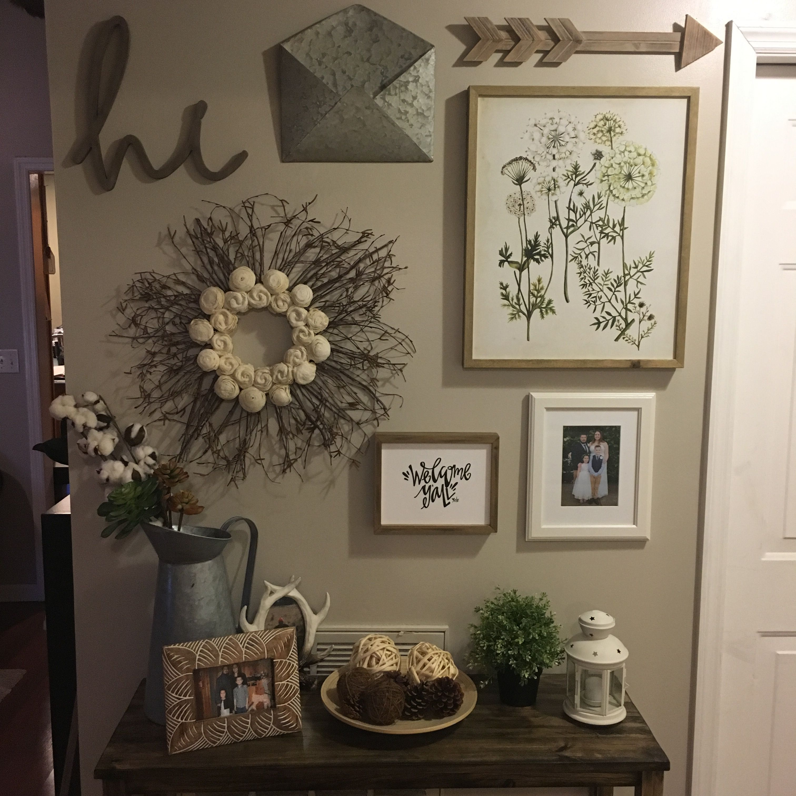 Entryway gallery wall with a rustic farmhouse theme, most