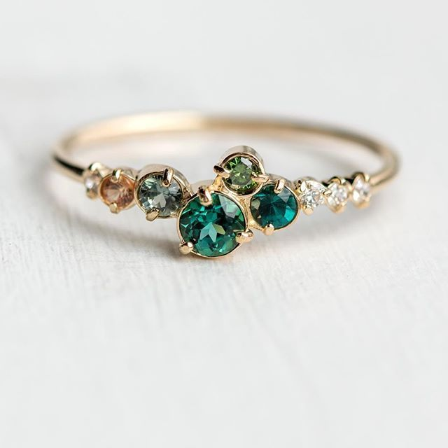 """Photo of Melanie Casey • Fine Jewelry on Instagram: """"New! Trellis in Giverny ring with a cluster of green gemstones, champagne diamonds, and a peach sapphire 🍑  This new piece was just added…"""""""