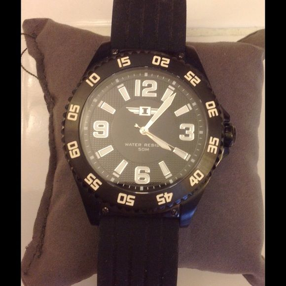 Men watch Bought it for my husband but he didn't like it. Has never been worn Accessories Watches