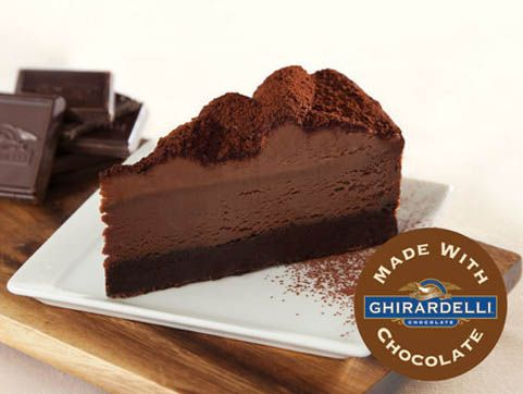 "A thick slab of rich fudge brownie made with Ghirardelli® Cocoa topped with a layer of smooth and creamy chocolate cheesecake made with Ghirardelli® Chocolate. Hand-piped chocolate mousse and a dusting of more Ghirardelli® Cocoa makes this a symphony of chocolatey tastes and textures. 9"" Cheesecake, serves 14.  #Cheesecake #Dessert #Ghirardelli"